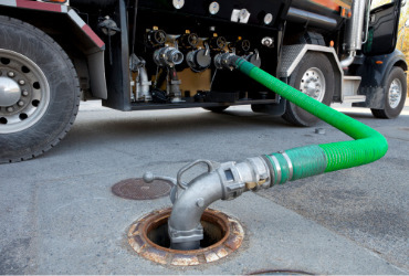 A tanker filling up a gas station during Gasoline Delivery in Peoria IL