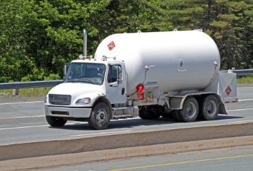 Propane delivery truck driving down the road